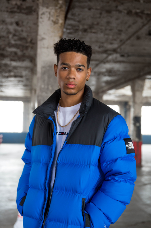 A man wears a blue The North Face jacket