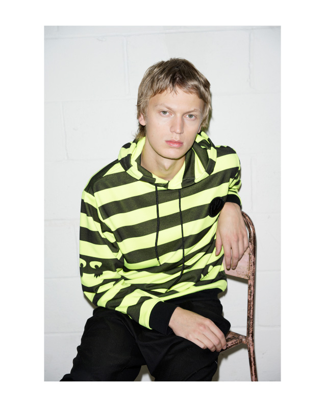 Man in striped MCQ shirt