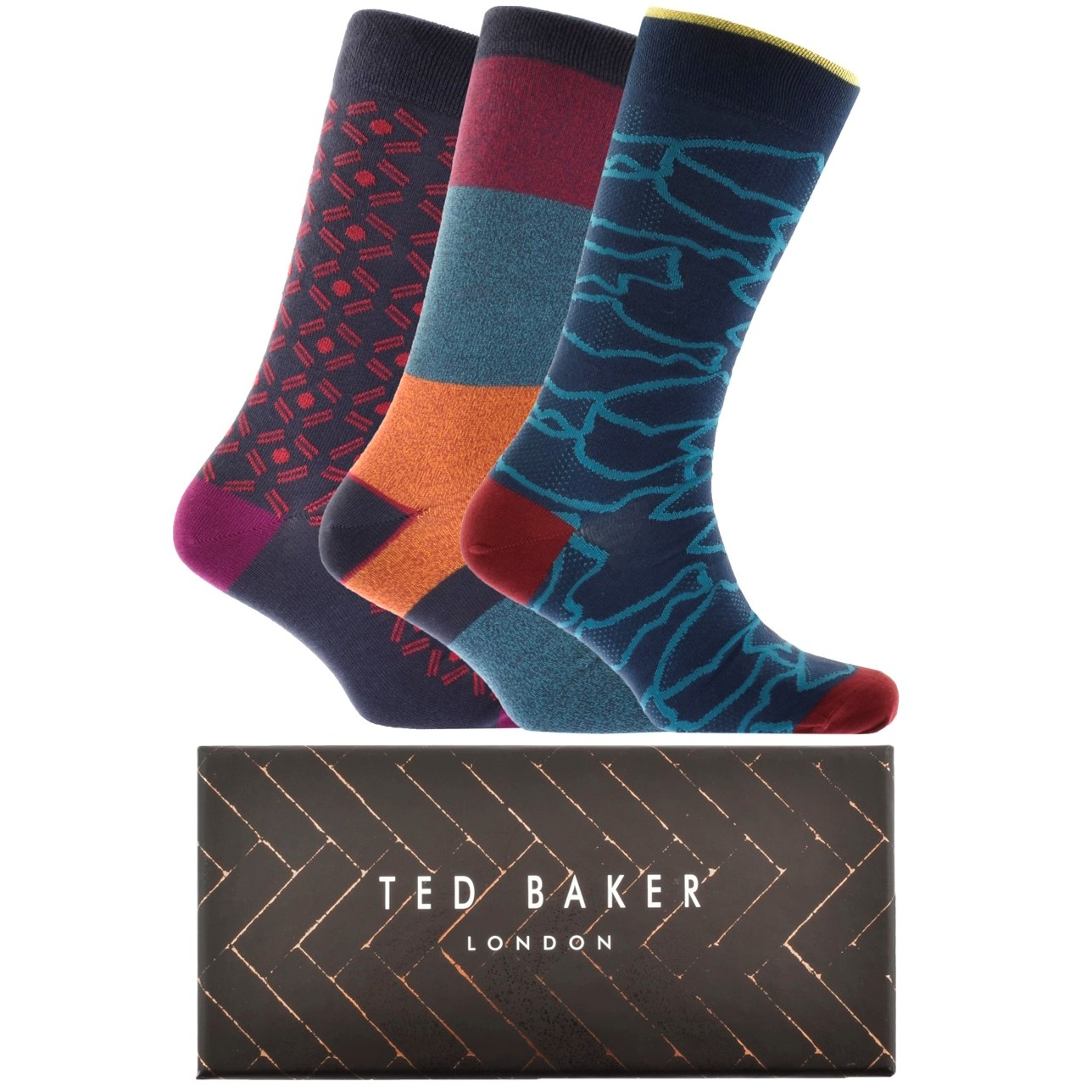three Ted Baker socks in blue and red patterns