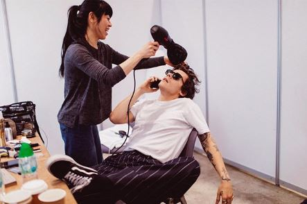 Harry Styles Having His Hair Blow Dried Wearing a white shirt