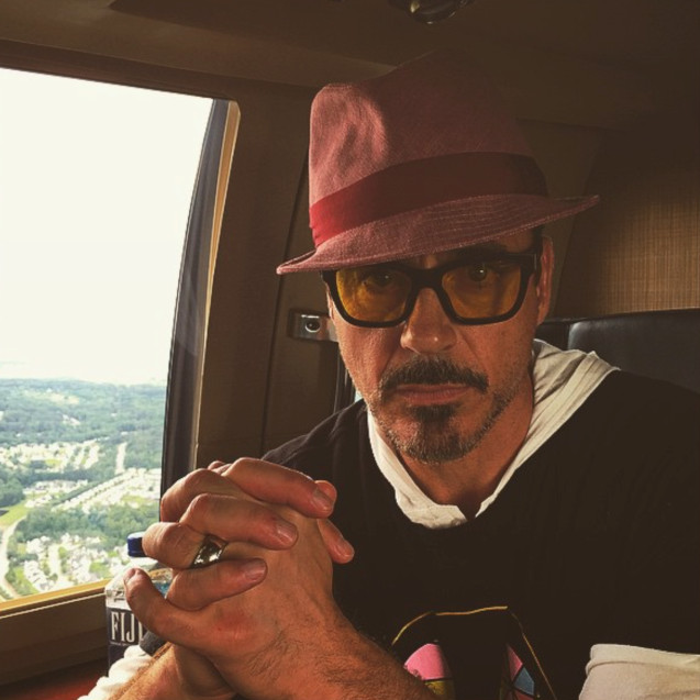 Robert Downey Jr. wearing tinted sunglasses on a plane