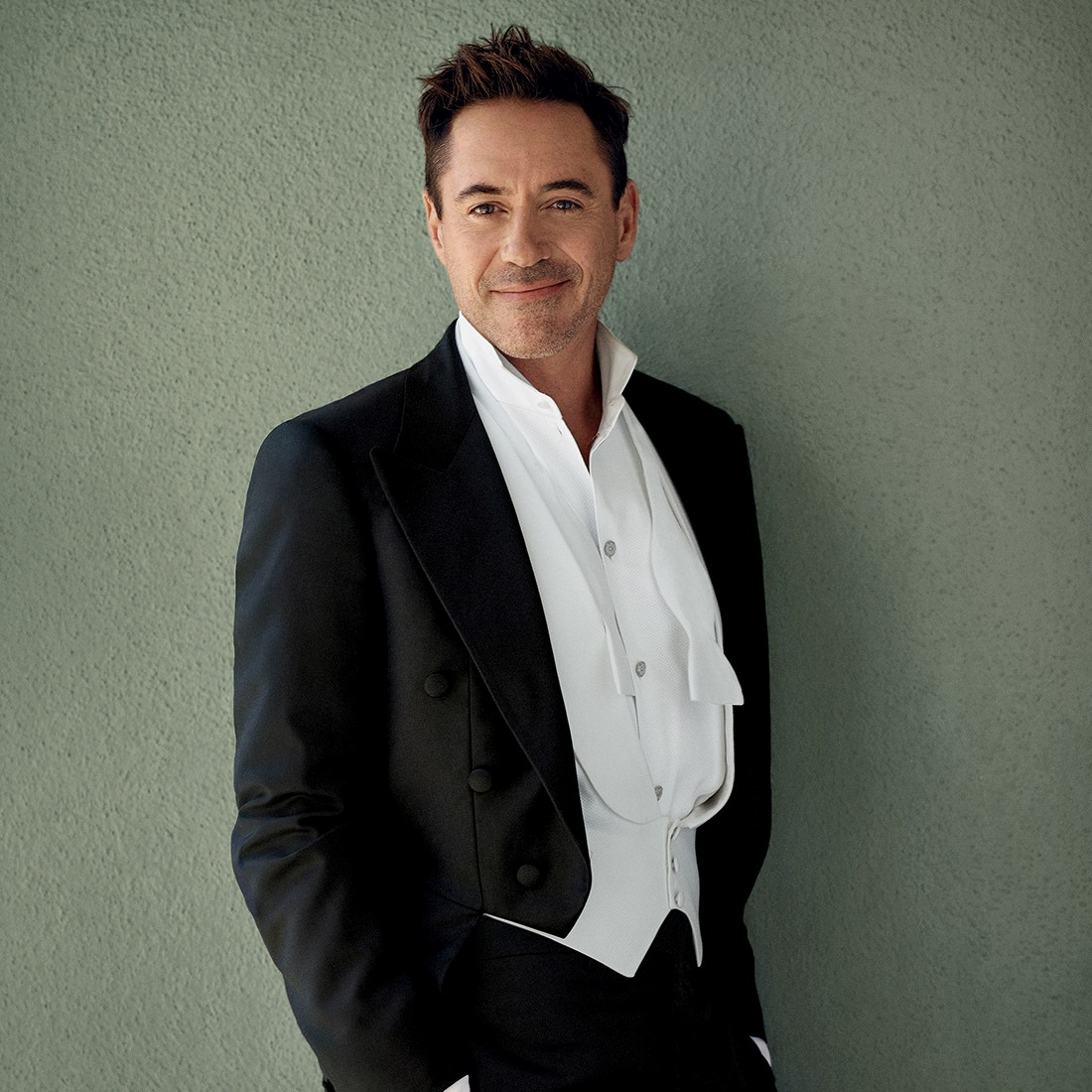 Robert Downey Jr. wearing a white shirt and white waistcoat