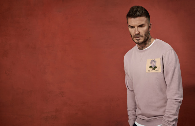 David Beckham Wearing a pink kent and curwen jumper