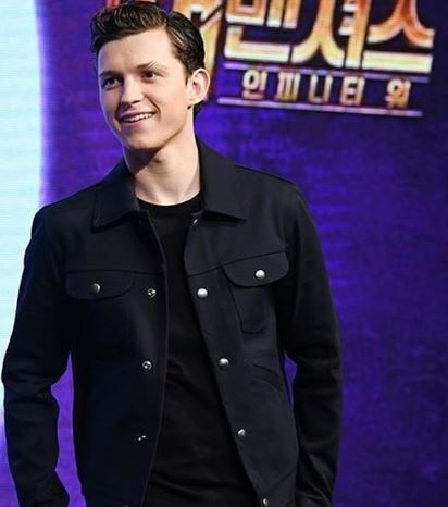 Tom Holland in black jacket and top
