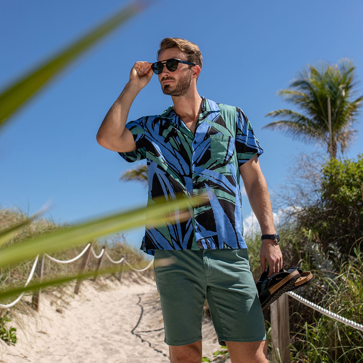 Man wearing printed t shirt on the beach