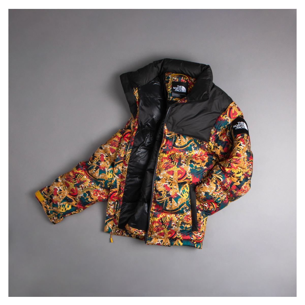 A North Face Coat In Bright Floral Patterns