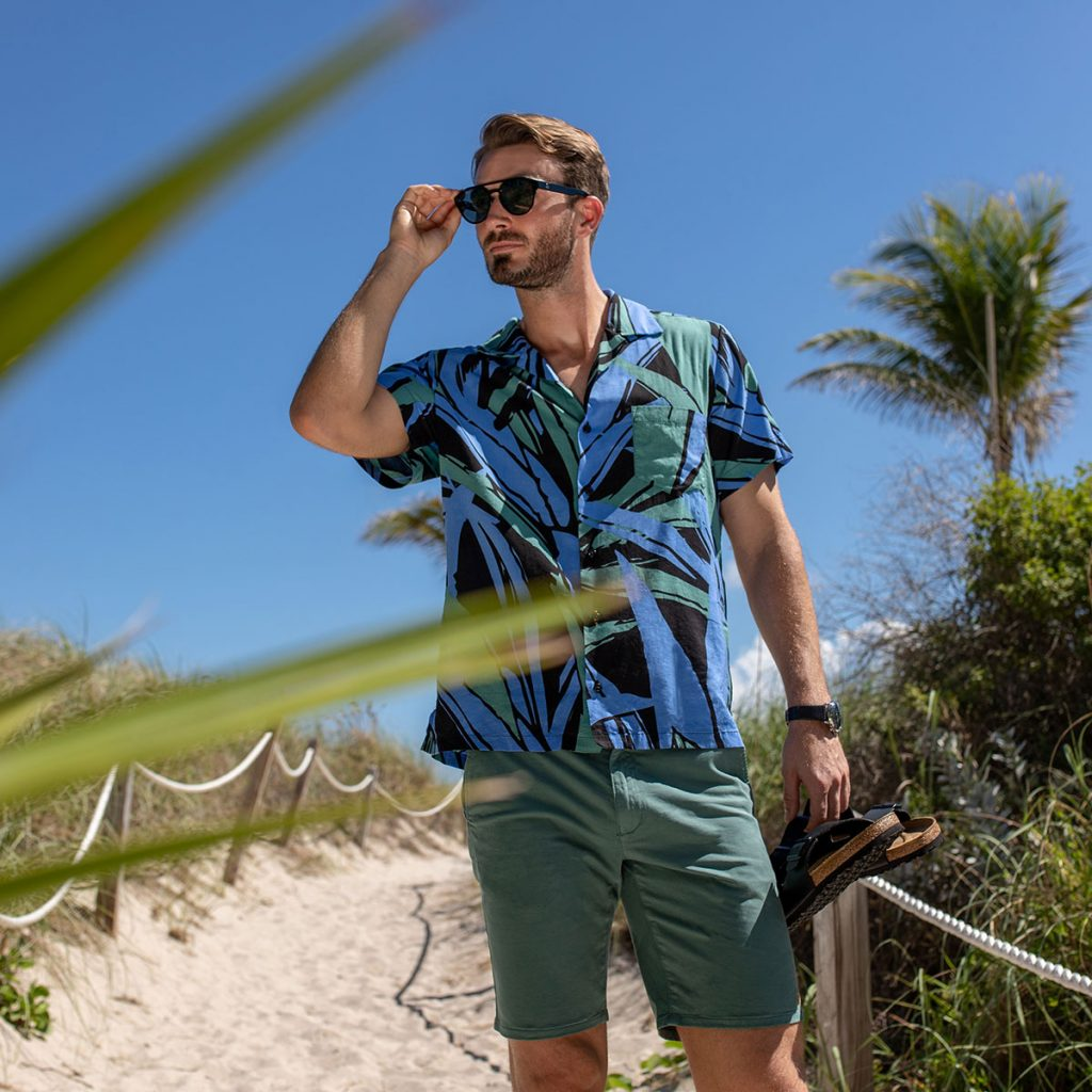 Man on beach wearing a cuban collared shirt