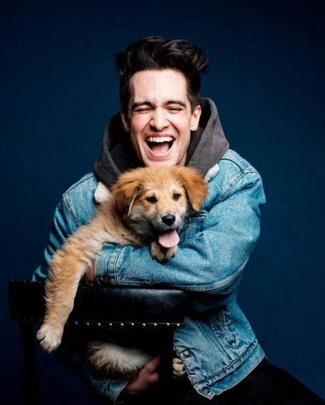 Brendon Urie Holding A Puppy