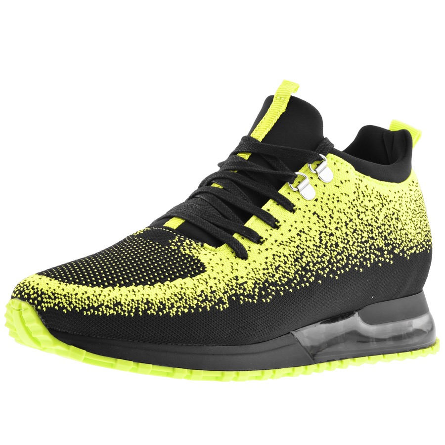 Mallet Tech trainers in black and dotted neon green highlighting