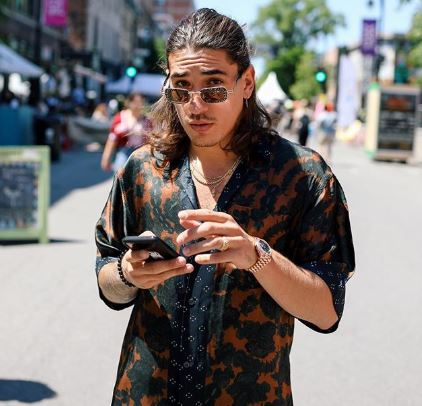 Hector Bellerin in a printed shirt on a sunny street