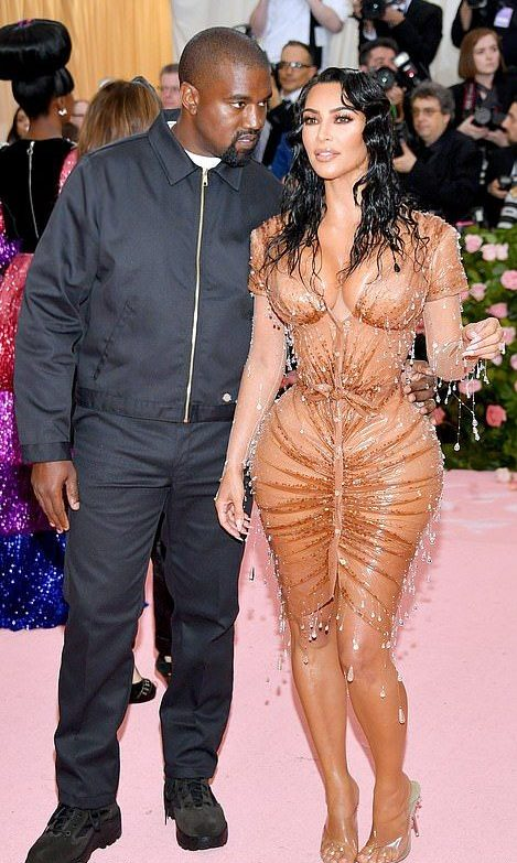 Kanye West at the Met Gala in an all black jacket trousers and trainers outfit, stood next to Kim Kardashian