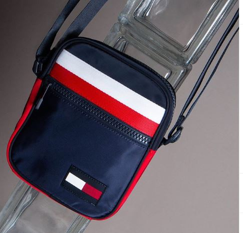 A blue, red and white Tommy Hilfiger bum bag