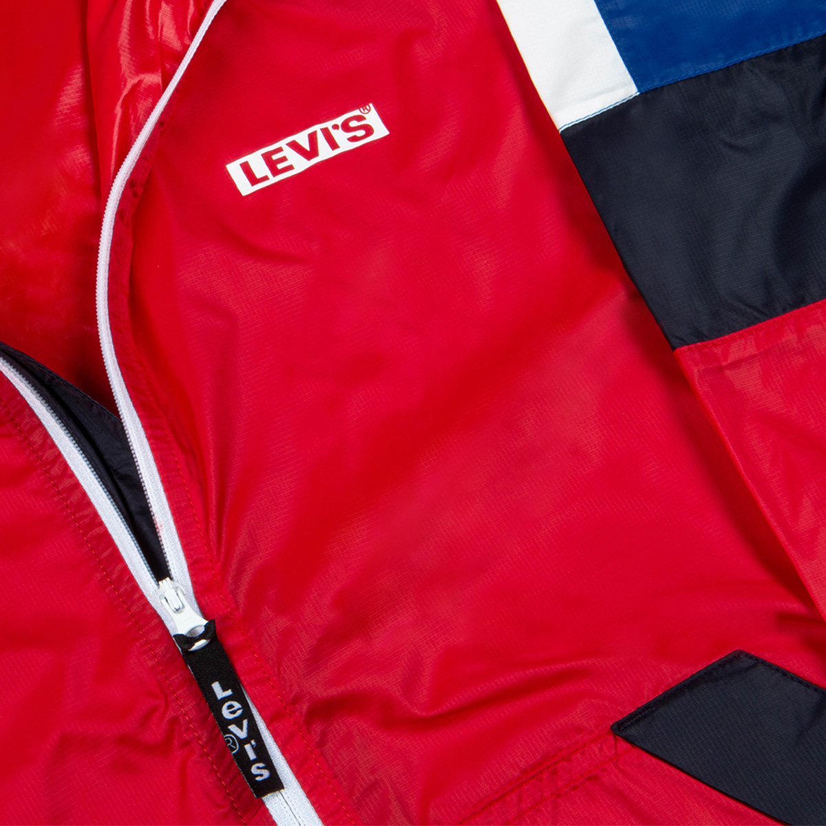 A bright red Levis' tracksuit top folded up neatly.