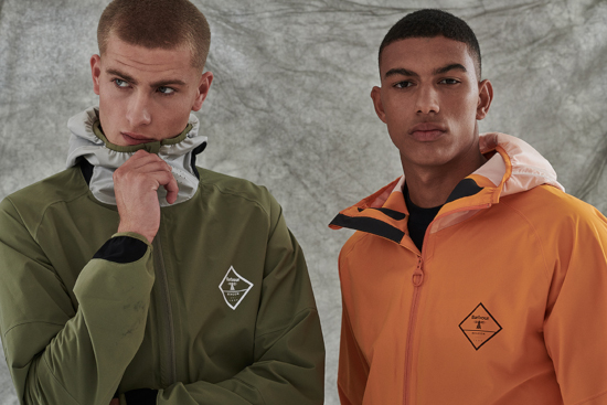 Barbour Beacon - two men are stood next to each other wearing Barbour Beacon rain coats in green and orange.