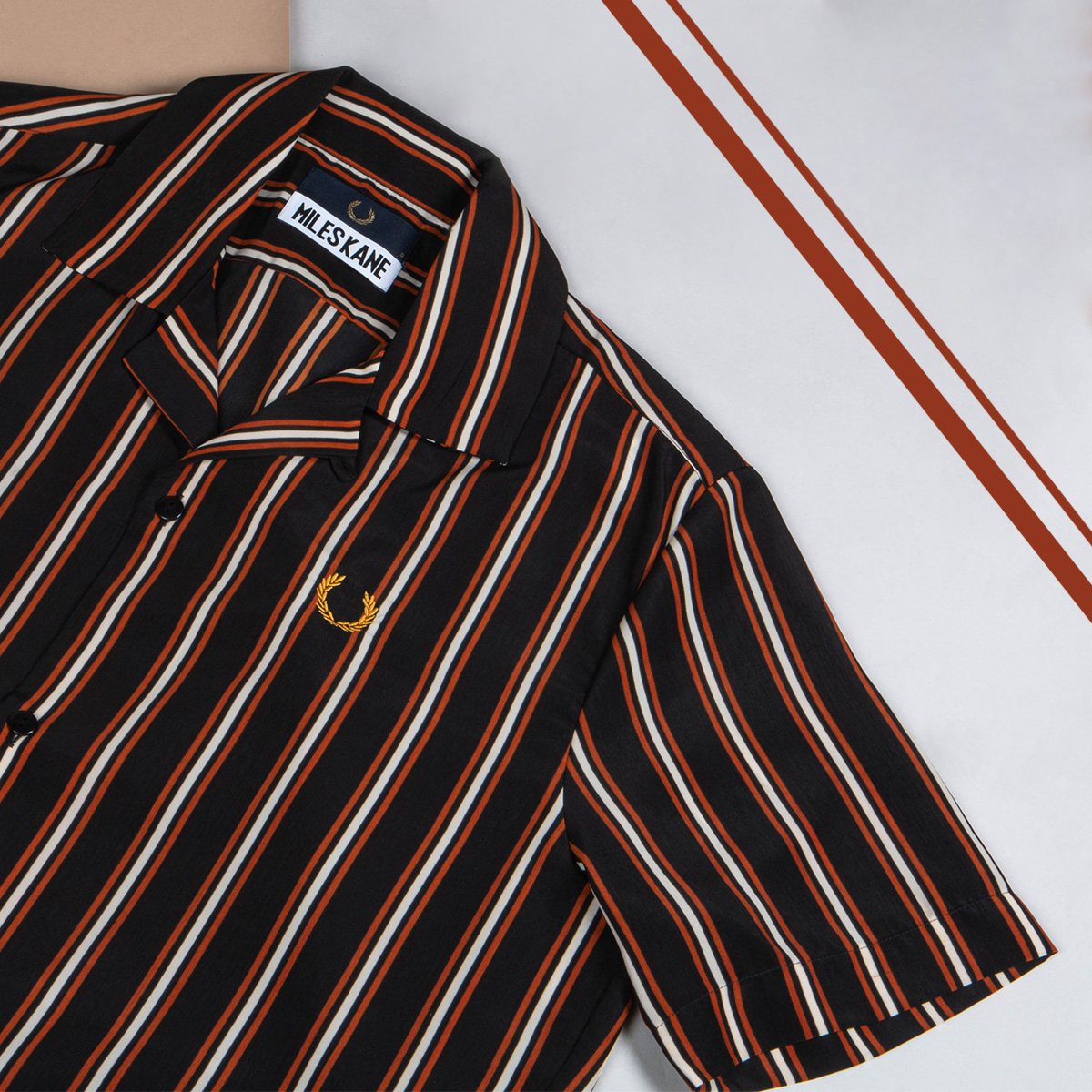 A red and white striped Fred Perry x Miles Kane shirt
