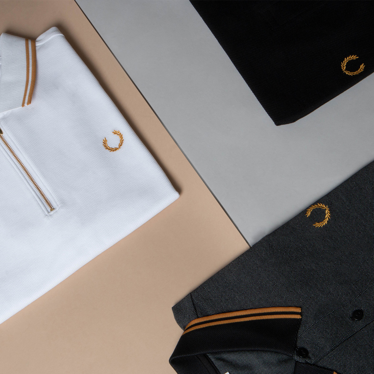 neatly folded Fred Perry x miles kane polo shirts