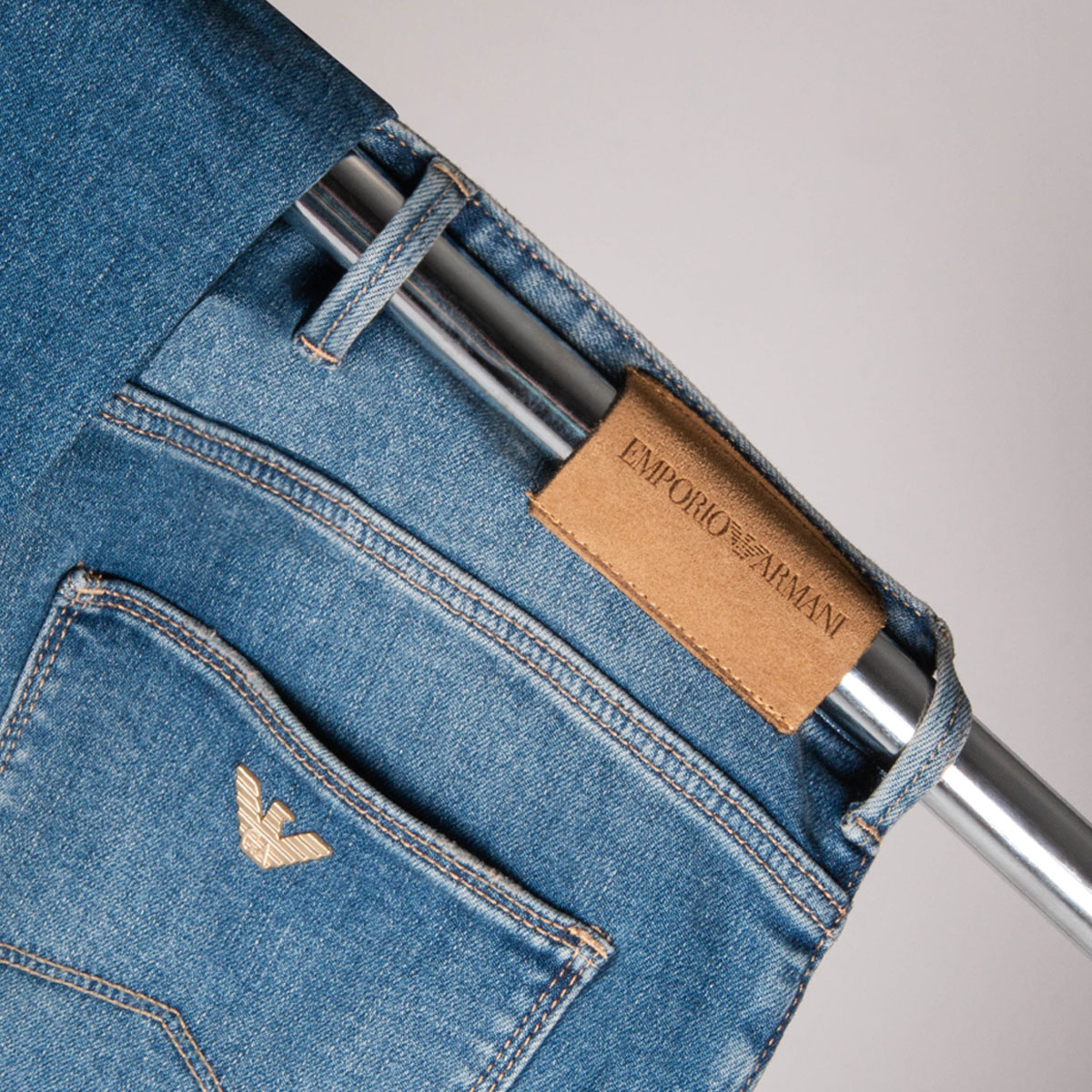 A close up of a pair of blue Emporio Armani jeans