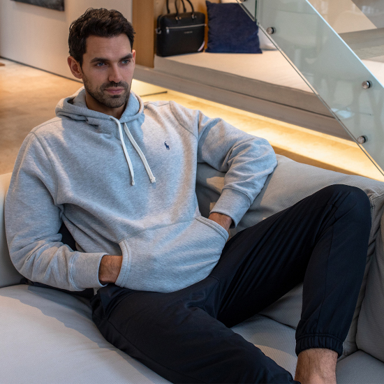 A man lounging in Ralph Lauren joggers