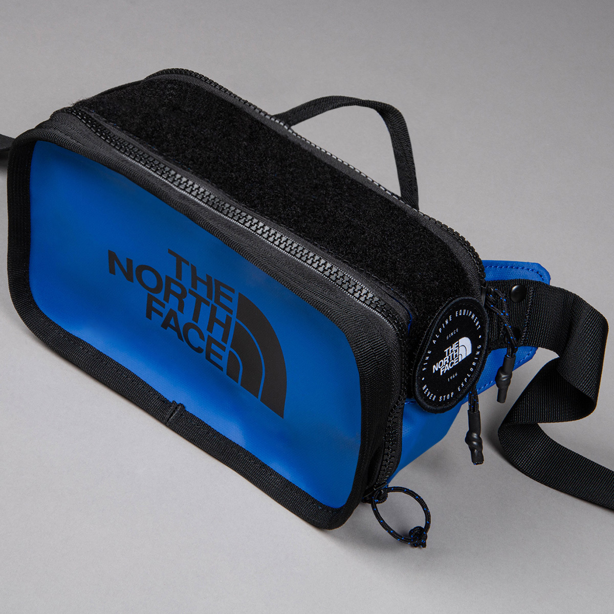 A blue The North Face cross body bag