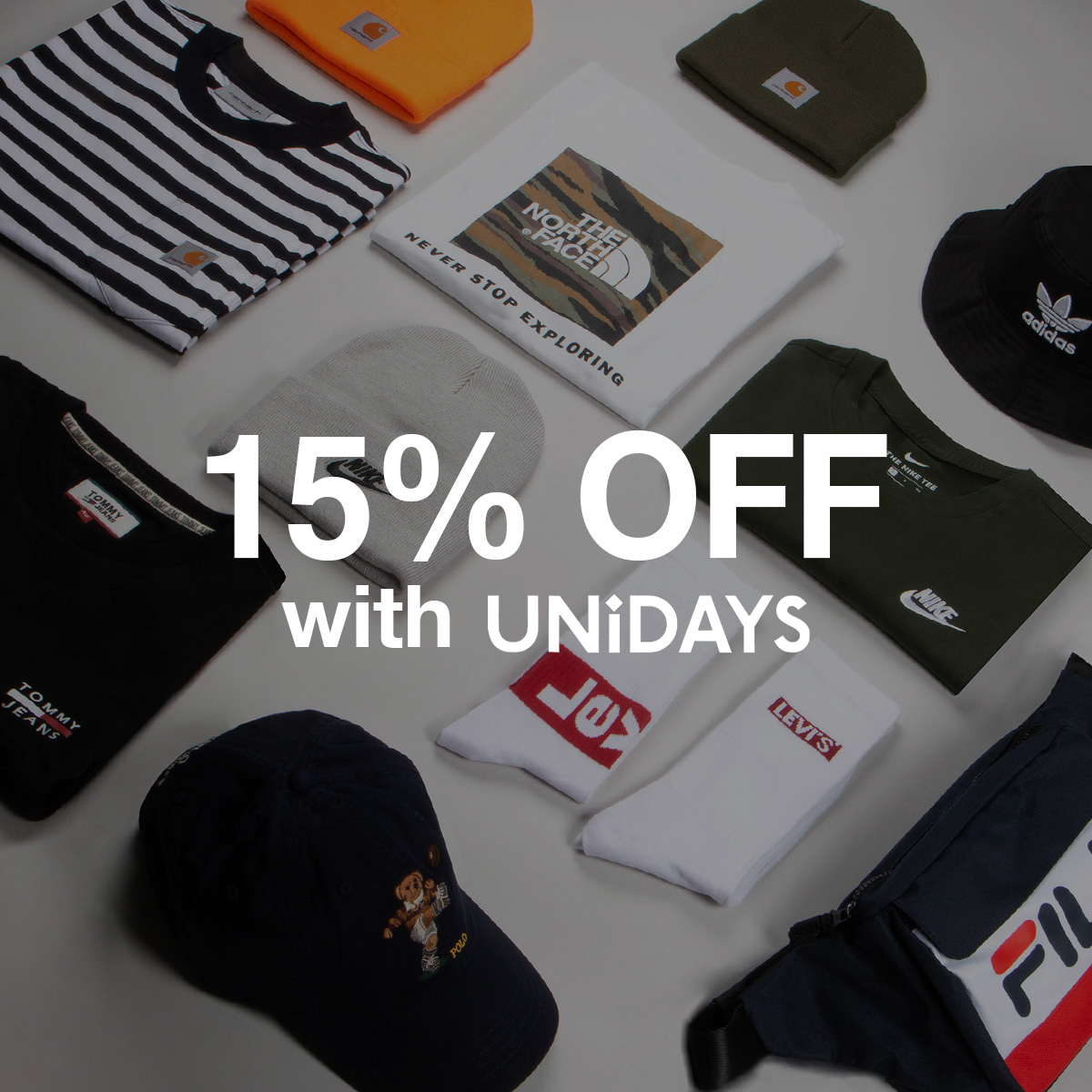 """designer t-shirts laird neatly on the floor with the text """"15% off with UNiDAYS"""" over the top."""