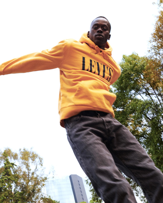 A man wearing a yellow Levis hoodie