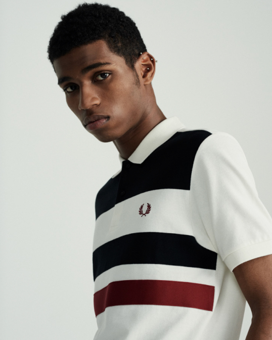 A man wearing a Fred Perry polo shirt