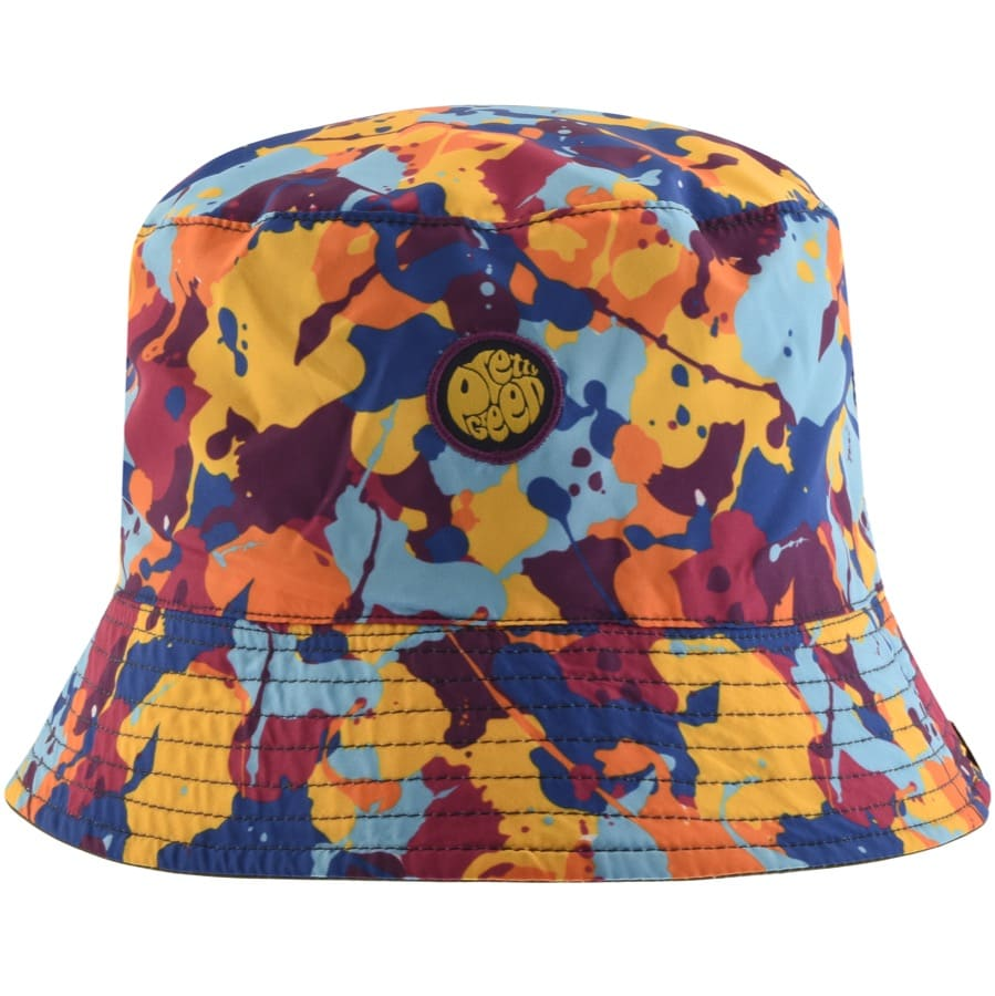 A bright camo bucket hat in orange, blues and red