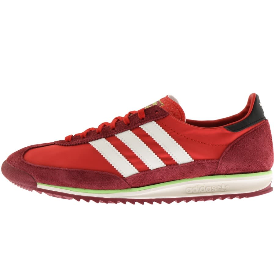Bright red adidas trainers