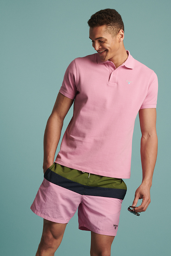 a man is grinning to the left wearing an all pink Barbour Beacon outfit